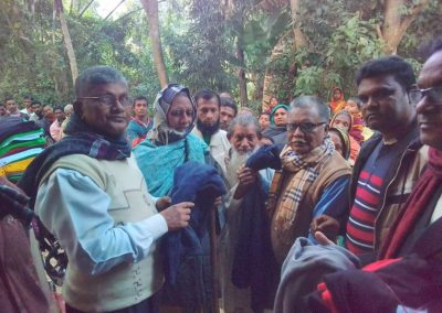 Distribution of Warm Cloths by Library Officials
