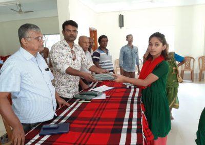 receiving new school dress donated by Mr Hasib Uddin, Adviser of Anirban & Chairman APS Group